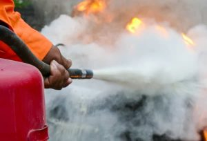 cleaning up a fire extinguisher discharge
